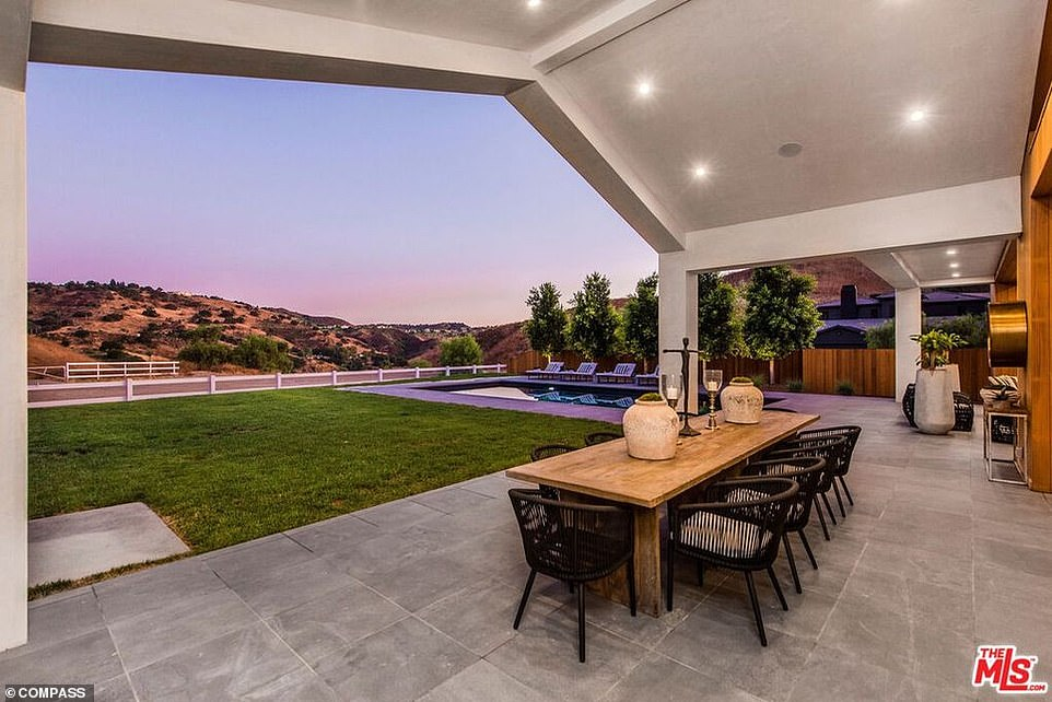 Light and airy: The home features an outdoor dining area with sumptuous views of the surrounding hills