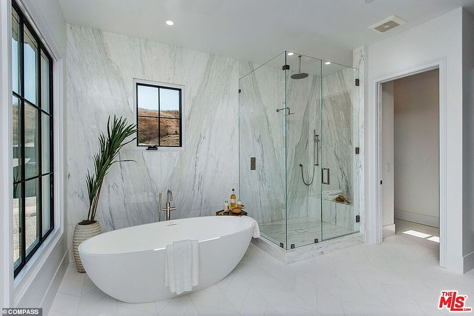 Heavenly: This bathroom has a tranquil vibe as well as views from the outside hills