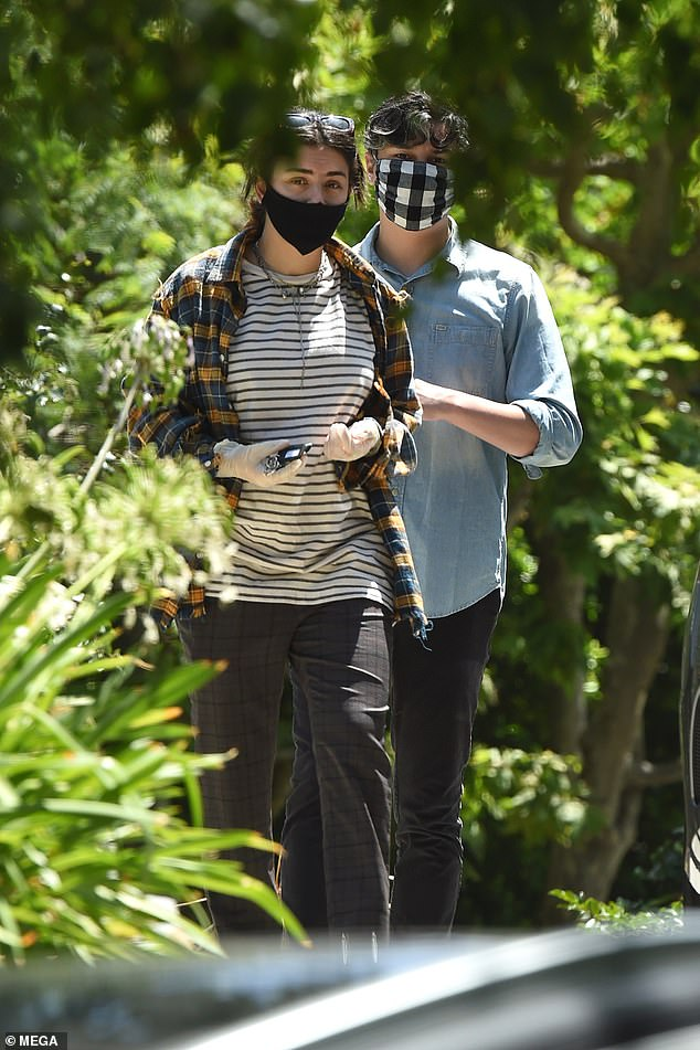 Careful: Charli XCX took no chances amid the coronavirus pandemic as she wore a face mask and gloves while enjoying an outing with beau Huck Kwong in Los Angeles on Monday