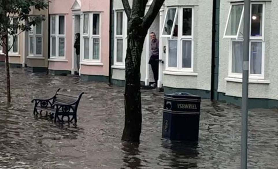 Thunderstorms have brought flash flooding and power cuts to parts of Wales, with Aberystwyth pictured yesterday