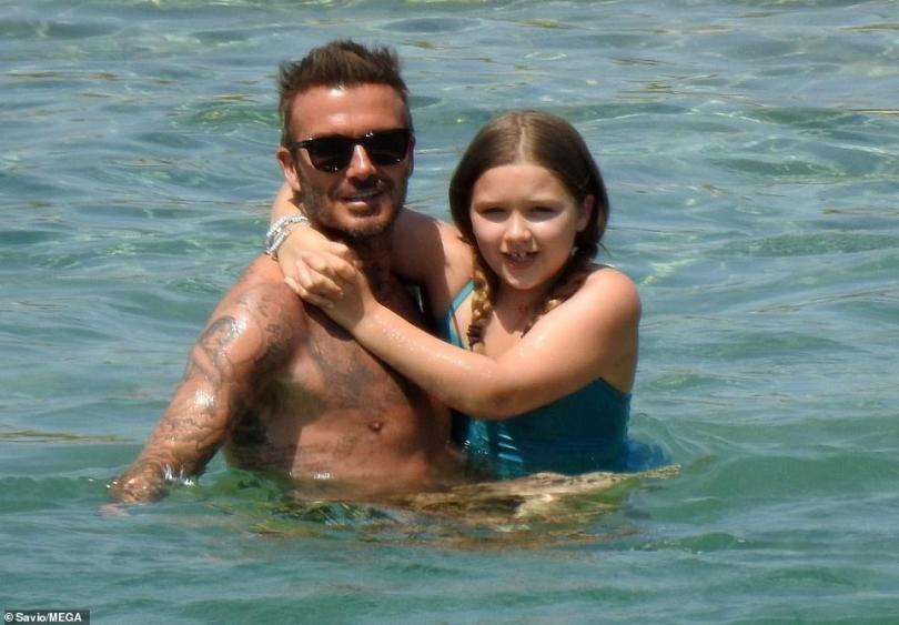 Close bond: Shirtless David Beckham doted on daughter Harper, 9, in the sea on their fun family holiday in Greece