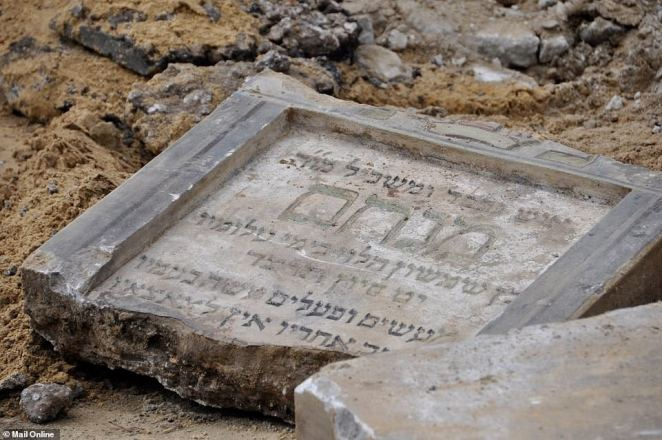 Construction workers discovered that the gravestones covered a 98-foot stretch of road