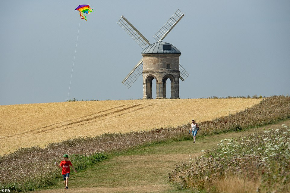 Ten-year-old Jack plays with his kite as he enjoys the hot weather by Chesterton Windmill in Warwickshire this morning