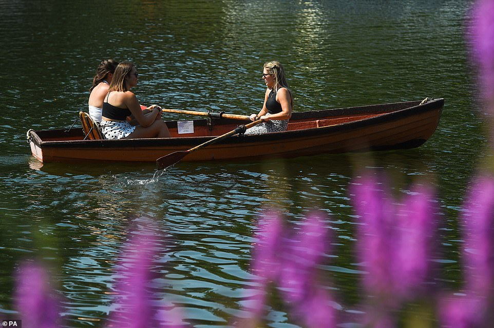 People rowing a boat as they enjoy the hot weather on the River Thames in Richmond, South West London, this afternoon