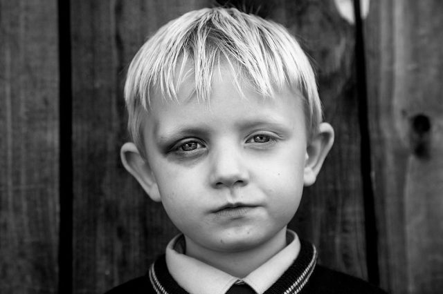 A young lad with a blackened left eye poses for a photograph taken by US photographer Jamie Johnson, after she spent five years gaining the trust of an Irish traveller community