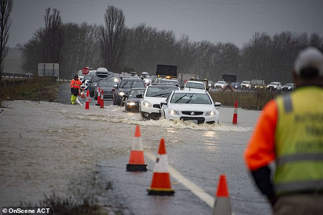 Cars were caught in rising waters in Canberra on Sunday (pictured)