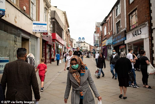Oldham's bars, restaurants, gyms and shops are at risk of closure due amid a sudden spike in coronavirus cases. Pictured: A pedestrianised street in the town on July 30
