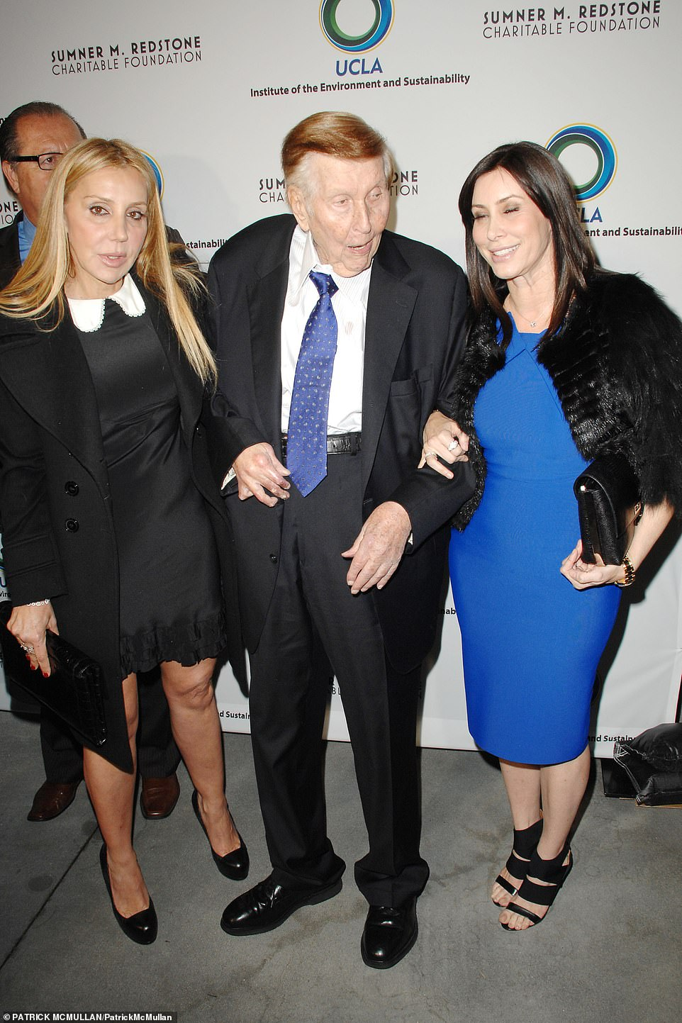 Redstone is seen in 2013 with his former loversManuela Herzer (left) and Sydney Holland