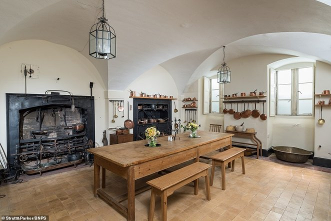 On the lower ground floor there is a games room, garden room, billiard room, studies, stores and the original kitchen, which has an Edwardian style (pictured)