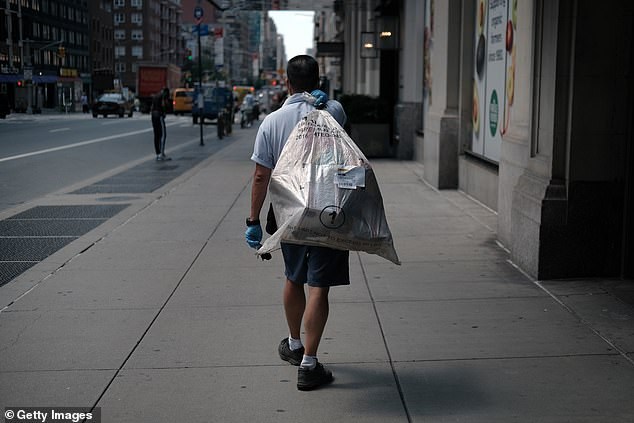 A United States Postal Service (USPS) carrier makes his rounds on August 5 in New York City. The USPS, the nation's national mail carrier service, is under increased scrutiny from politicians who are warning that the agency is not prepared to handle the tens of millions of mail-in ballots which are expected to be sent for the November election
