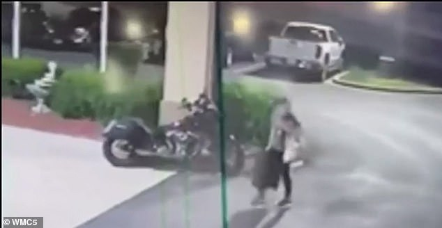 In the footage, Carter is seen walking across the parking lot of the hotel with her luggage