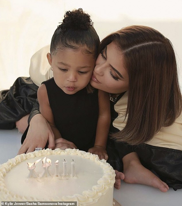 Make a wish: Kylie had Stormi's help when she blew out the candles on her cake, calling her little one 'the best gift ever'