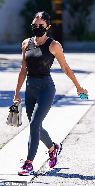 The actress, 31, was dressed in skintight tank top and leggings for her errand