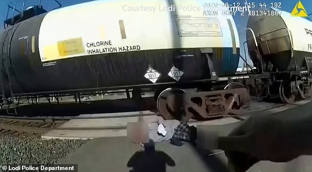 The police officer in Lodi, California, rescued the 66-year-old man with only seconds to spare as the train sped past at around 8:45pm on August 12