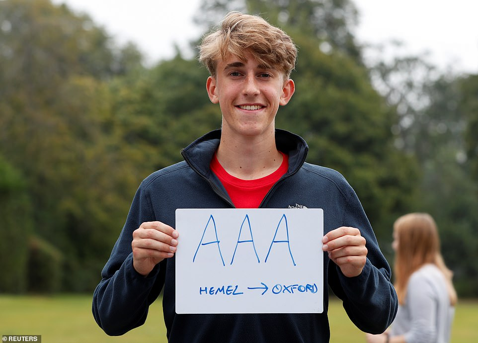 A sixth form student poses with a piece of paper after receiving his A-Level results at The Hemel Hempstead School today