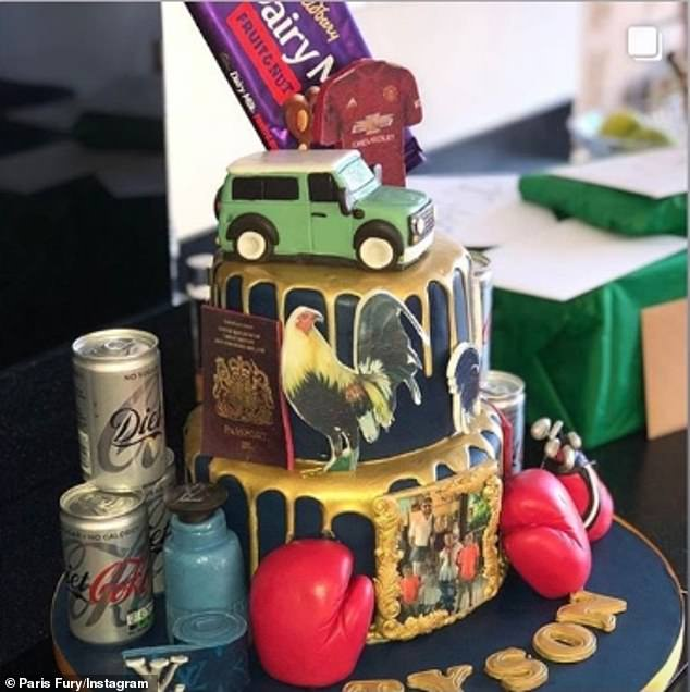 Spoilt: The sportsman's cake featured all the things he loves including a Louis Vuitton belt, boxing gloves, cans of Diet Coke and a European passport