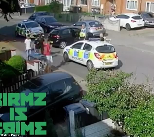 The three car passengers appeared back into the camera shot and brazenly walked past officers