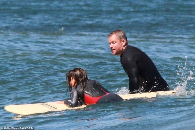 Daddy's girl: Gia looked like quite the mini-me, sporting a red and black Roxy wetsuit