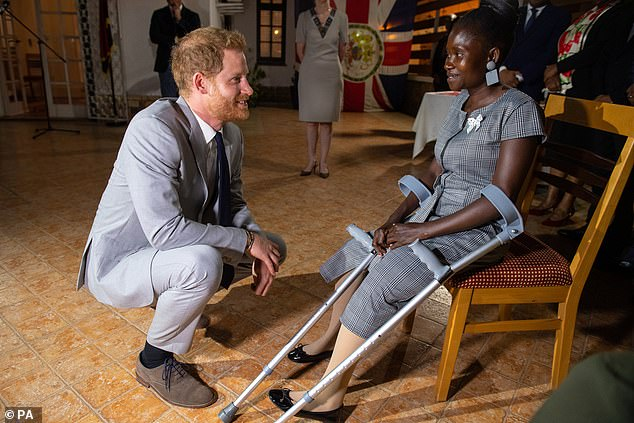 The Duke of Sussex meets landmine victim Sandra Tigica, who Princess Diana met on her visit to Angola 1997, during a reception at the British Ambassadors Residence in Luanda, Angola, on day five of the royal tour of Africa