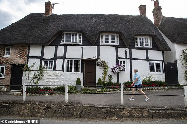 The controversial decision to remove the pews was made because of health and safety fears, to improve disabled access and to avoid potential embarrassment for obese couples who may struggle to walk down the narrow aisle. Pictured: The Dorset village of Okeford Fitzpaine