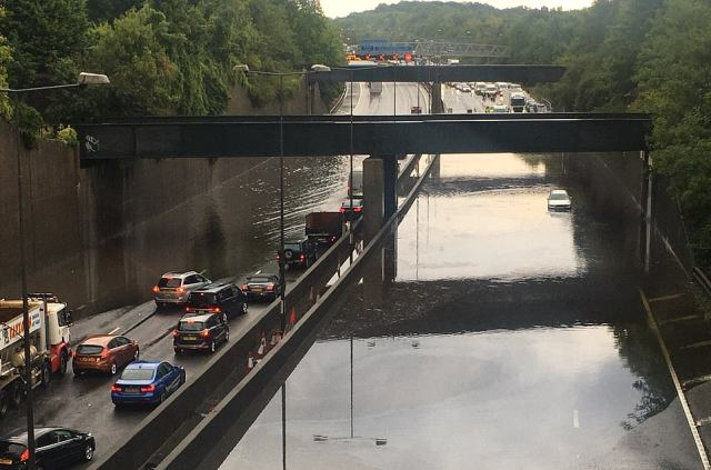 The M25 was brought to a standstill by floodwater on Thursday, with only one slightly treacherous in use anti-clockwise and a BMW driver forced to abandon their car in the clockwise lane
