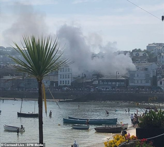 A huge cloud of smoke billowed across the skyline at the waterfront in St Ives after the blaze started at The Balcony Bar and Kitchen
