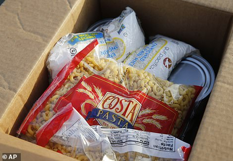 Rice and pasta filled boxes as well as canned goods donated by Texans as families struggle to put food on the table
