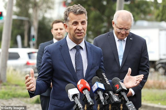 Transport Minister Andrew Constance (pictured) warned masks could become mandatory unless more people follow government advice