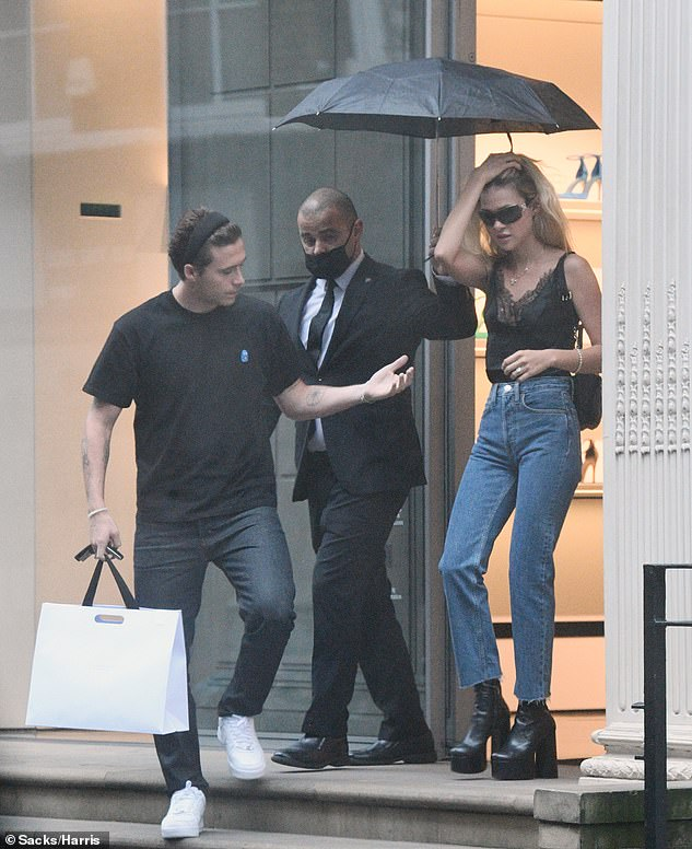 Low-key:Brooklyn opted for a low-key look in a black T-shirt and dark baggy jeans for the Thursday outing