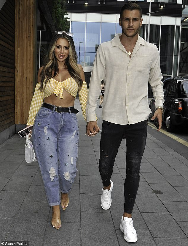 Loved-up! Holly Hagan, 28, and her fiancé Jacob Blyth looked as loved-up as ever as they walked hand-in-hand for a romantic dinner at the Ivy in Manchester on Friday