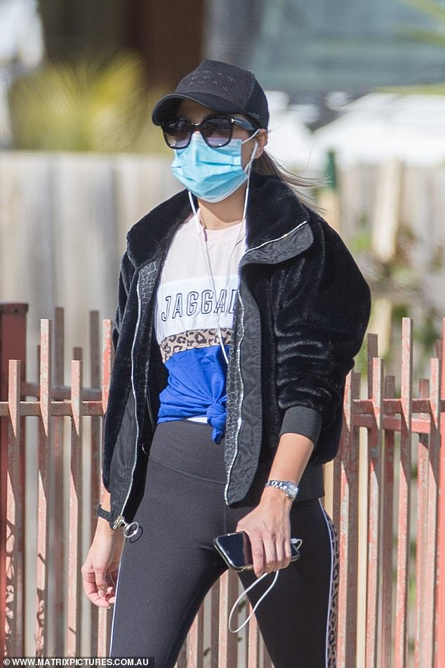 Stylish: Irena dressed in head-to-toe Jaggad activewear, wearing a blue, white and leopard print T-shirt from the brand which is co-owned by AFL WAG, Rebecca Judd