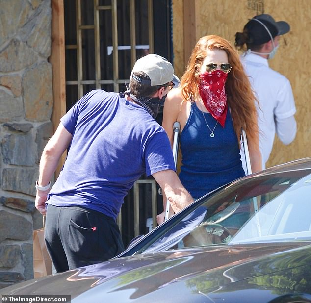 Chivalrous:The Mad Men actor was seen opening the car door for his former costar, 32, who was walking with the aid of crutches