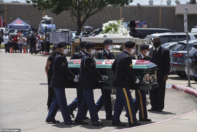 Military personnel carry Guillen's casket from a horse-drawn carriage to Cesar Chavez High School for her memorial