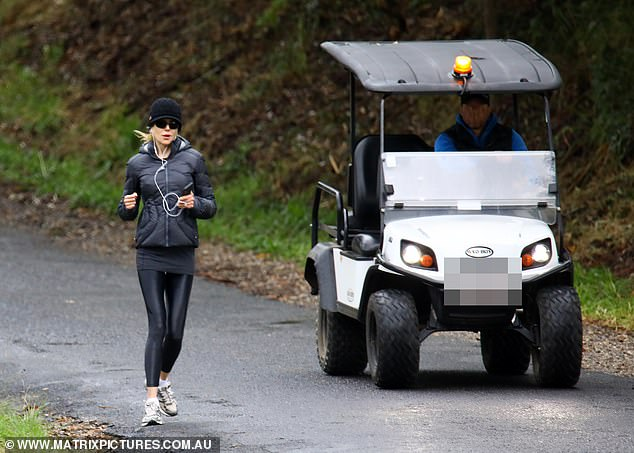 Safety: The A-lister was closely accompanied by security, who kept up with her stellar pace by following behind in a golf buggy