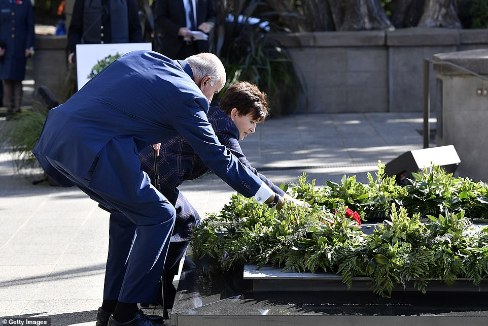 Governor General Dame Patsy Reddy and husband Sir David Gascoigne lay flowers on the steps of the Pukeahu National War Memorial Park to commemorate the 75th anniversary of the end of the Second World War today in Wellington, New Zealand