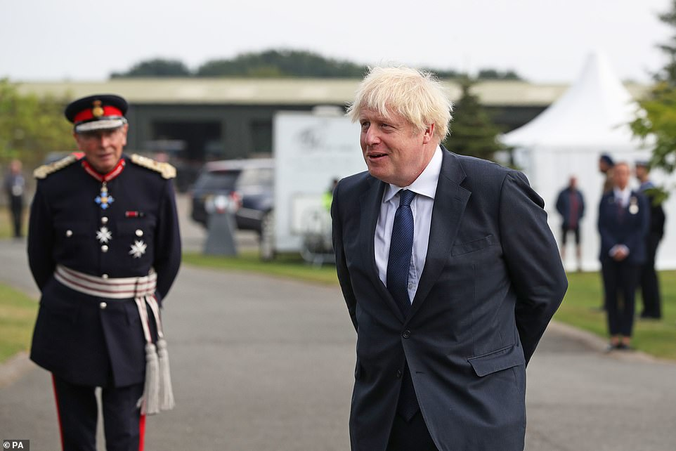 Prime Minister Boris Johnson arrives to attend the national service of remembrance marking the 75th anniversary of VJ Day at the National Memorial Arboretum in Alrewas, Staffordshire today