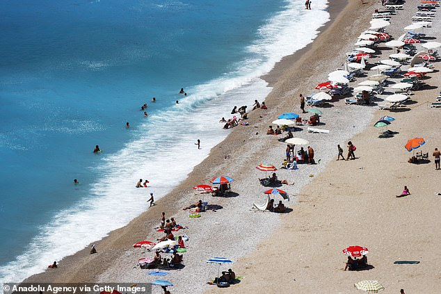 The cost of holidays to quarantine-free Turkey (a beach in Turkey pictured earlier this month) and Greece has plunged by 28 per cent on average while a week-long trip to Italy has halved in price, comparison website Travel Supermarket found