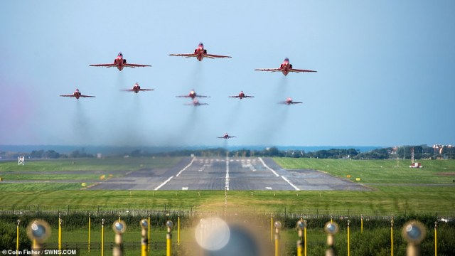 On the 75th Anniversary of VJ Day (Victory in Japan Day) the RAF Red Arrows aerobatic display team are seen taking off from Prestwick International Airport, Prestwick, Scotland today