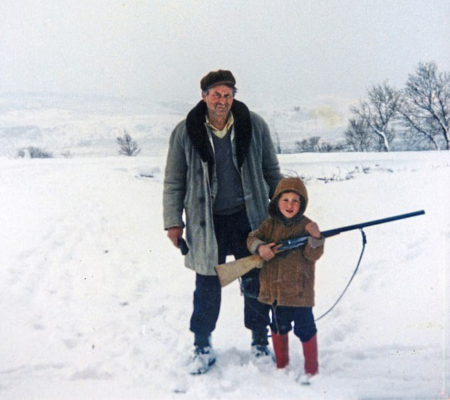 A young Modric pictured going hunting for rabbits with his grandad, who was tragically killed