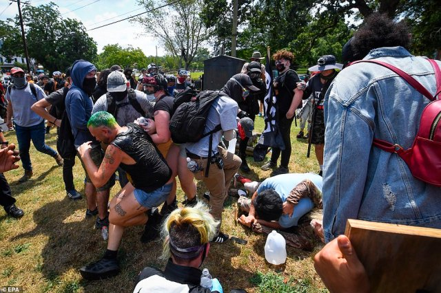 A fight breaks out between demonstrators and counter demonstrators after tensions between the two groups boiled over