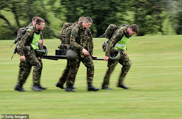 More than 100 solders in the British Army's Royal Logistics Corps were given the incorrect results in their promotion tests. Pictured: File photo of junior soldiers taking an endurance test