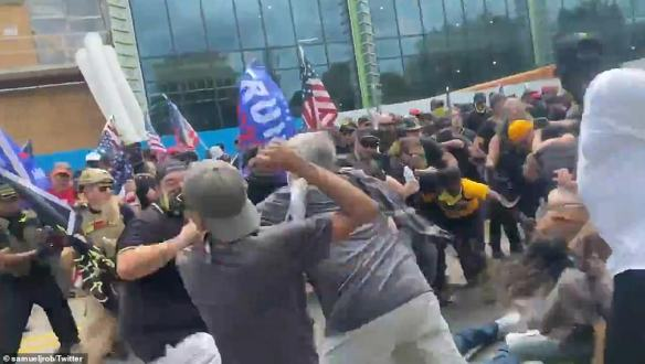 Punches were thrown and people were being shoved and kicked to the ground in the Michigan city on Saturday