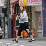 Radio host Chrissie Swan steps out for a takeaway coffee in a leopard-print face mask