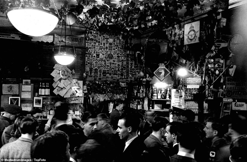 Vice and crime share the same streets as those who go in search of innocent employment, with a black and white photo revealing the inside of a bar in Soho filled up with people around the mid-twentieth century