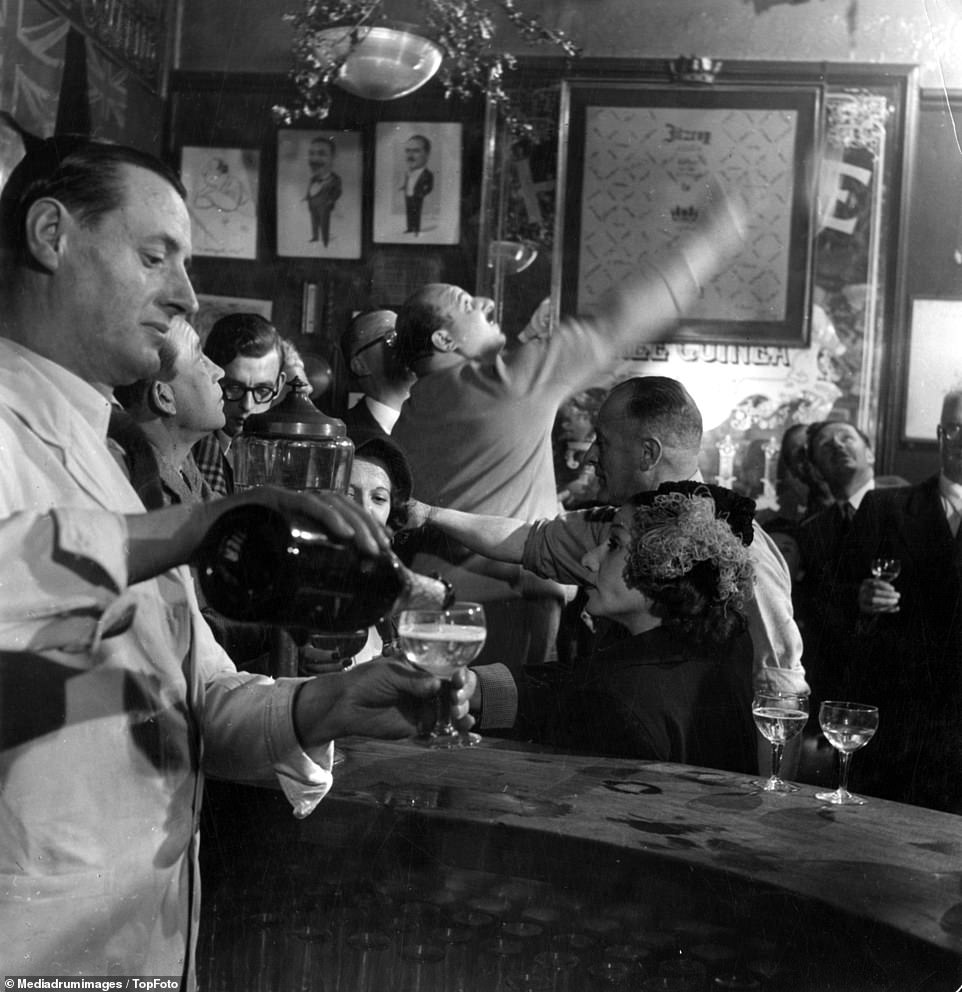 The Fitzroy Tavern in Soho on February 22, 1949, showing raucous revellers and a barman pouring drinks. The pub, situated in the Fitzrovia district and became famed during the 1920s to 1950s