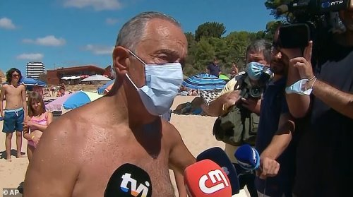 Pictured: The president speaks to journalists on the Algarve beach on Saturday. Footage of the incident shows the 71-year-old president, who underwent a minor heart operation last year, front-crawling out to the overturned kayak as a man on a jet ski approaches to help the rescue effort
