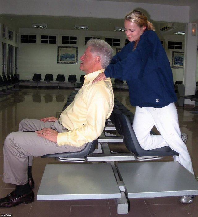 Bill Clinton is seen enjoying a neck massage from a Jeffrey Epstein victim in never-before-seen photographs obtained exclusively by DailyMail.com. Clinton sits comfortably and laughs as Chauntae Davies, then a 22-year-old massage therapist, rubs her hands into his shoulders