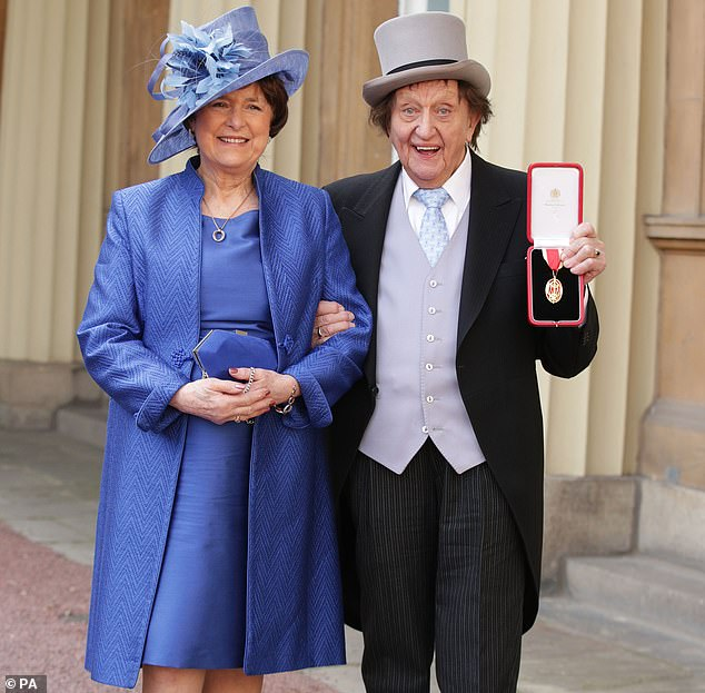 Comedy legend Sir Ken Dodd, with his then-partner Anne Jones at Buckingham Palace, London, after he was made a Knight Bachelor of the British Empire by the Duke of Cambridge in 2017