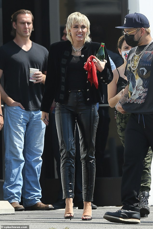 To work! Miley Cyrus was spotted leaving a photoshoot in Los Angeles on Tuesday, working out PVC pants and a military-style button-down jacket