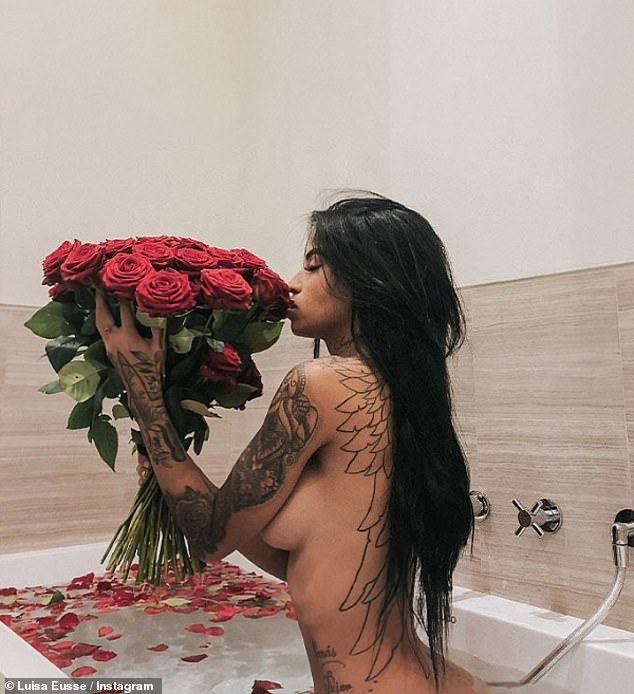 Sensual: Luisa recently shared a steamy photo of herself in the bath where she appeared to have been gifted with a large bouquet of red roses
